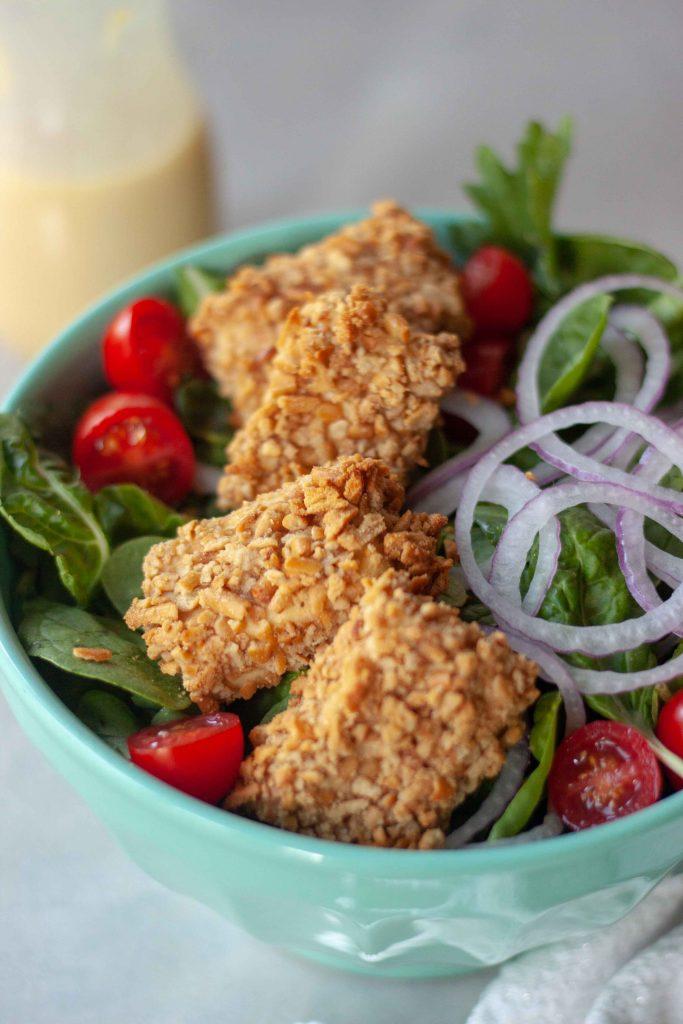 Close up of Pretzel Crusted Tofu on Salad