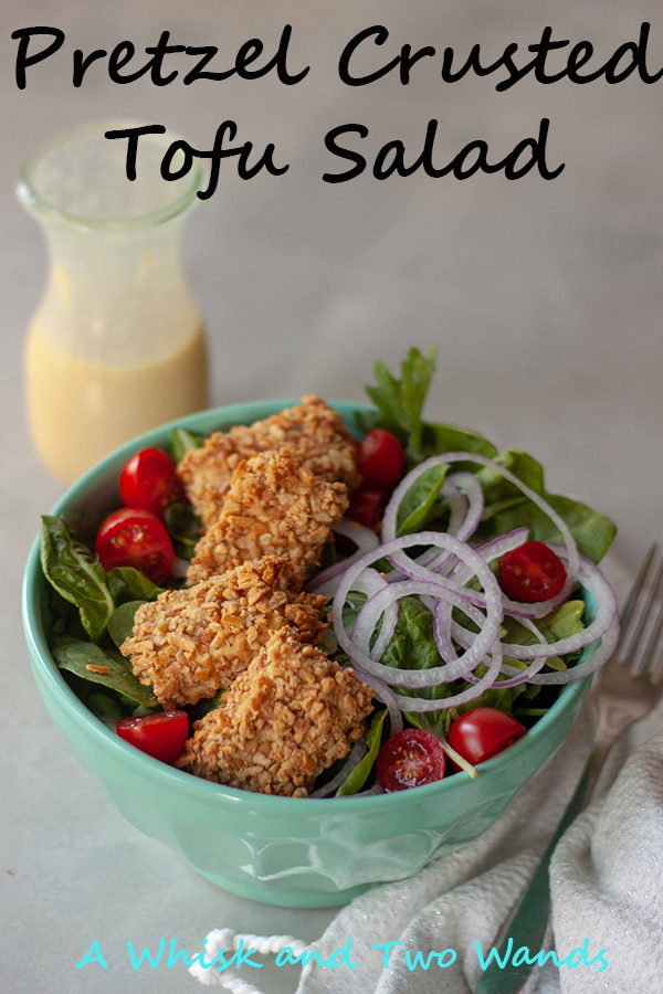 Pretzel Crusted Tofu Salad is a bed of greens topped with tomatoes, onions, crunchy gluten-free pretzel crusted tofu nuggets, and drizzled with homemade honey mustard dressing! Quick and easy it makes a great weeknight dinner.