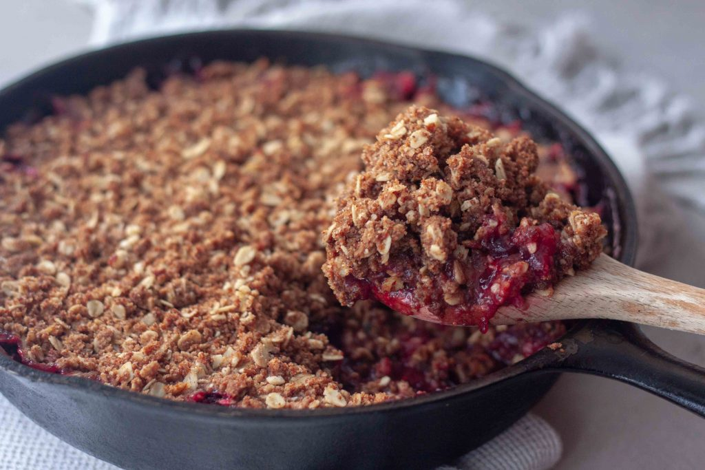 Cast Iron Cranberry Crisp with spoon