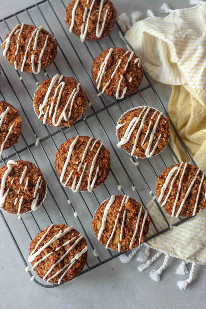 Carrot Cake Oatmeal Muffins drizzled with Cashew Cream