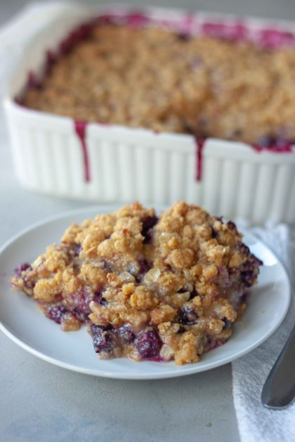 Piece of Sweet Corn Blueberry Crisp with pan behind