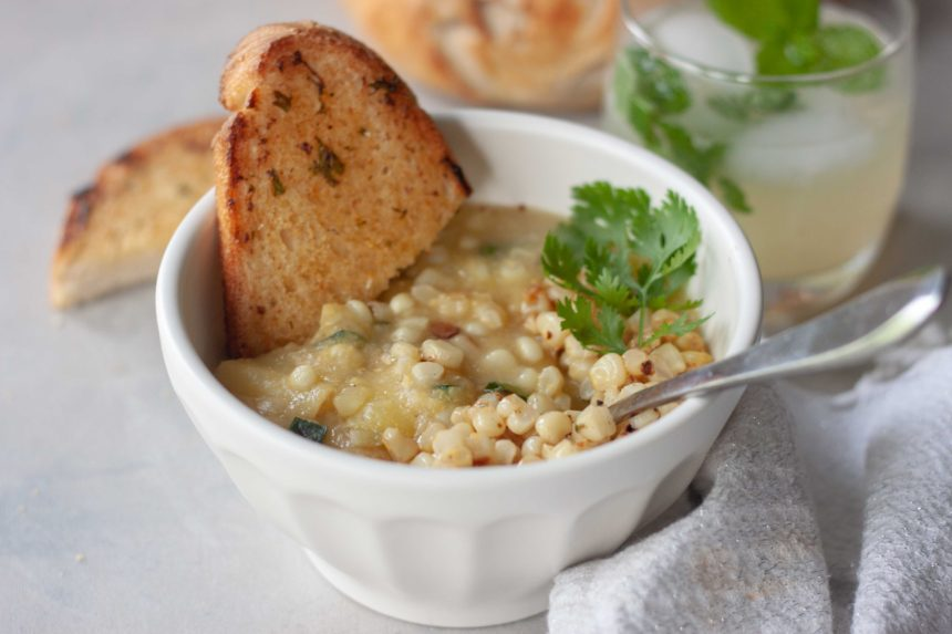 Bowl of Spicy Sweet Corn Soup with Sautéed Chili Lime Corn with toasted bread and spoon