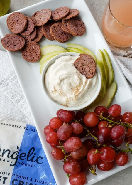Platter with Angelic Bakehouse Sprouted Crisps, yogurt dip, pears, and grapes