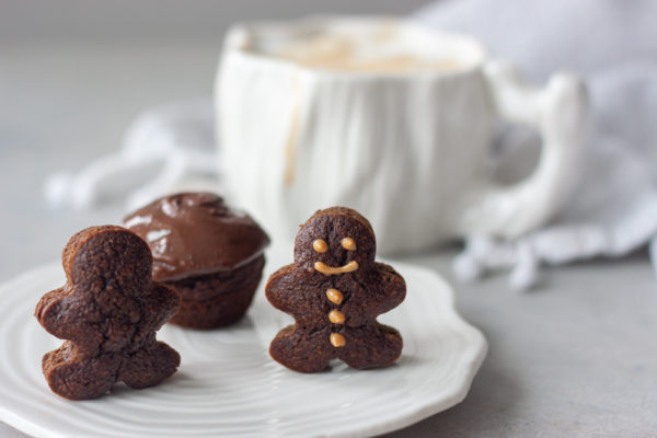 Mini Gingerbread Man Muffins with coffee mug in background