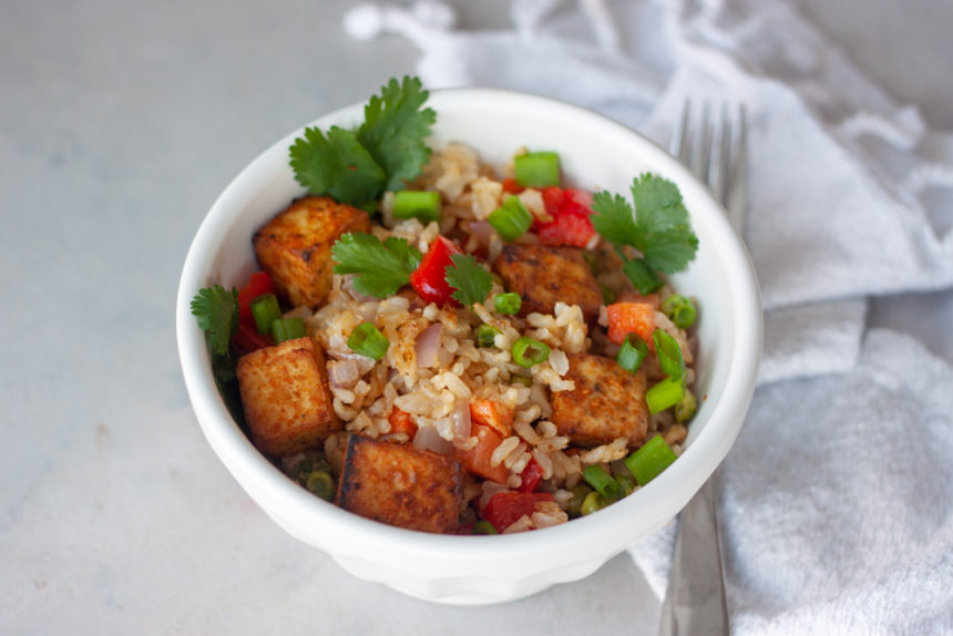 Peruvian Tofu Oven Fried Rice Bowls will take your taste buds on a trip around the world! Vegan and gluten free friendly with a little prep this easy to make meal will having you rethink take-out any night of the week and quickly become a family favorite!