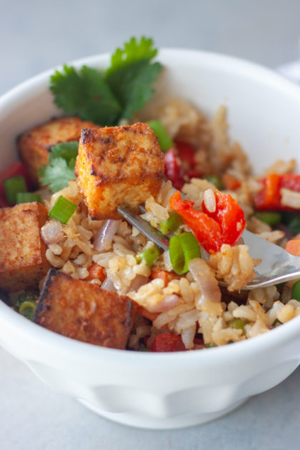Peruvian Tofu Oven Fried Rice Bowl with fork