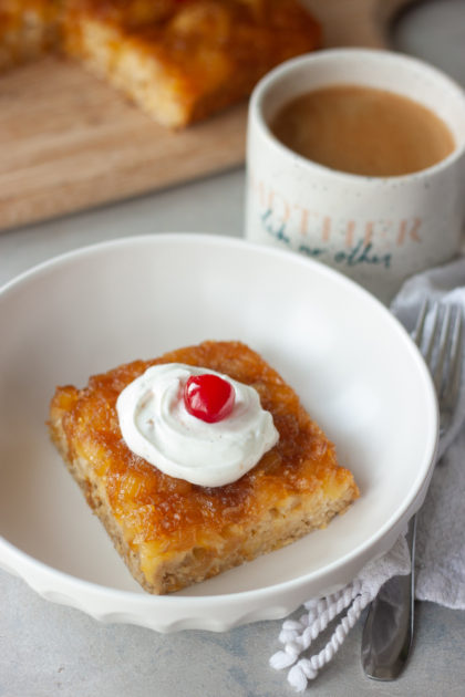 Pineapple Upside-Down Oatmeal Cake in bowl with coffee