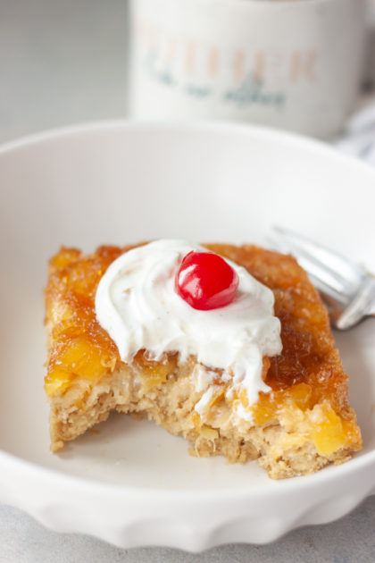 Pineapple Upside-Down Oatmeal Cake in bowl with bite and fork