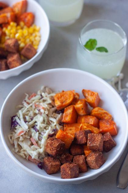bowl with bbq tofu, coleslaw, sweet potato, limeade