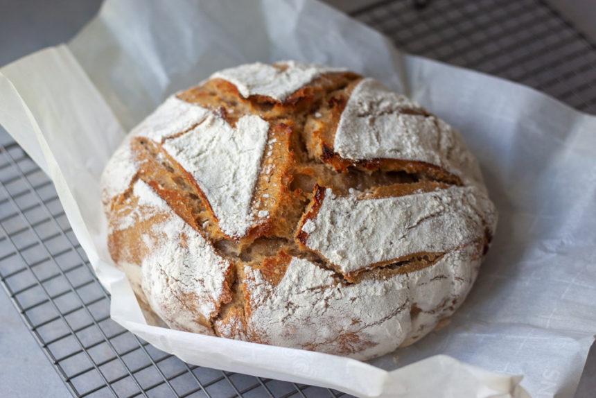 Loaf of Social Distancing Spelt Sourdough Bread on cooling rack