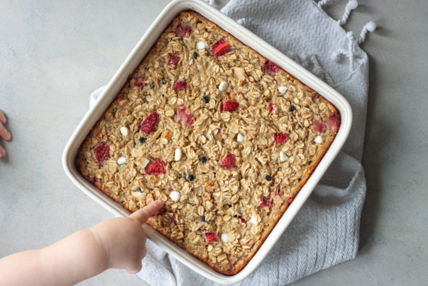 Red White Blueberry Muesli Baked Oatmeal with toddler hand