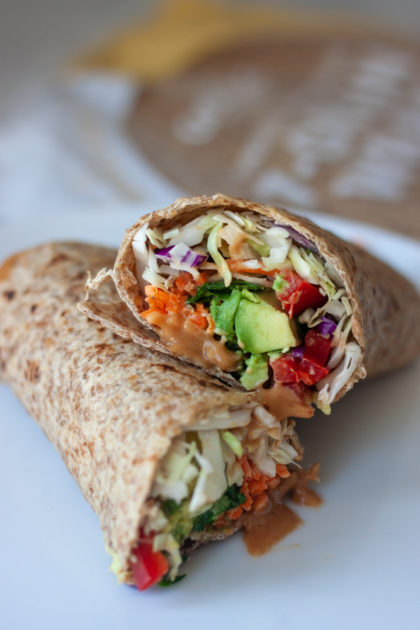 Spice things up for lunch with Sprouted Thai Veggie Wraps with Peanut Sauce! Sprouted wraps packed with sweet potato, carrots, peppers, avocado, and Thai Peanut Sauce! Not a wrapper dip all the veggies in Thai Peanut Sauce or make a salad bulking up veggies, adding mango and or optional peanuts. Vegan and gluten free friendly.