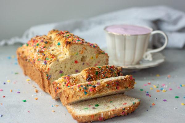 Sliced Sprinkle Scone Loaf and pink latte