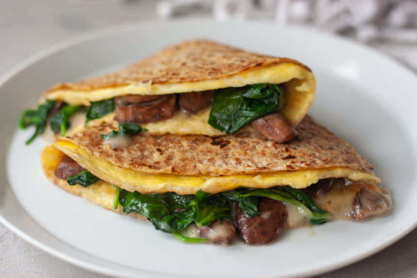 Oma-dilla with mushrooms, baby spinach, and cheese
