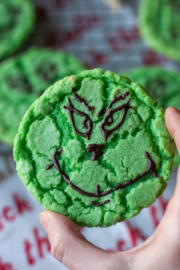 holding a Grinch Crinkle Cookie