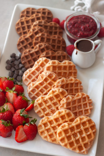 Strawberry and Chocolate Waffle Brunch Board with berries, jam, chocolate, and whipped cream