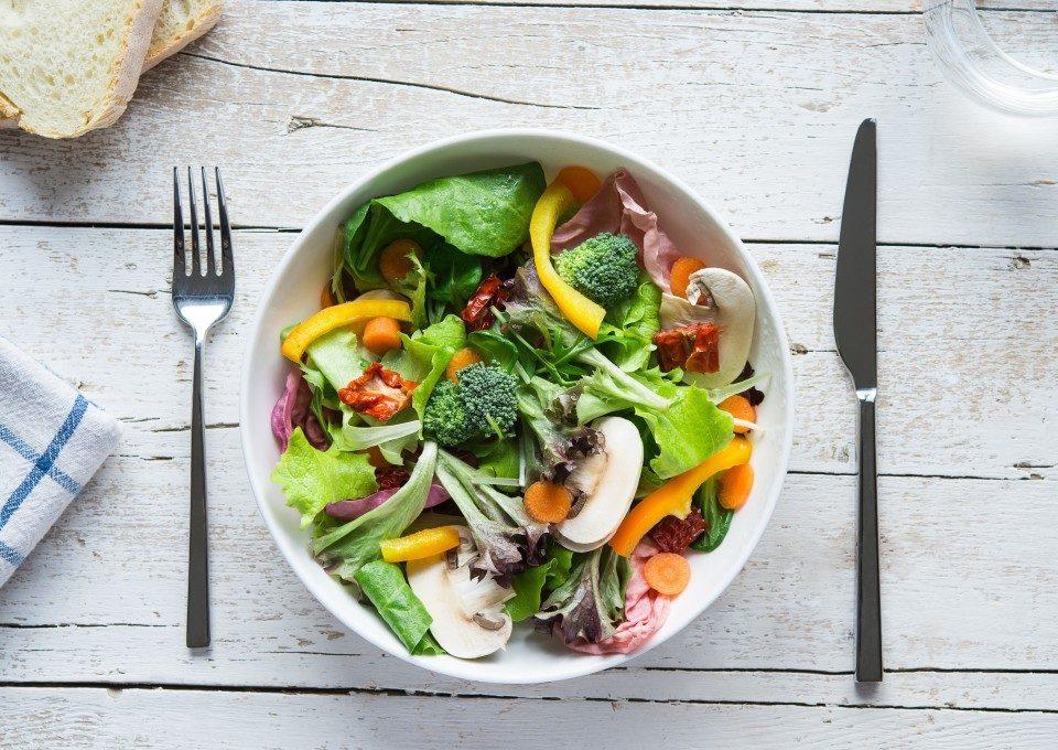 White bowl full of vegetables