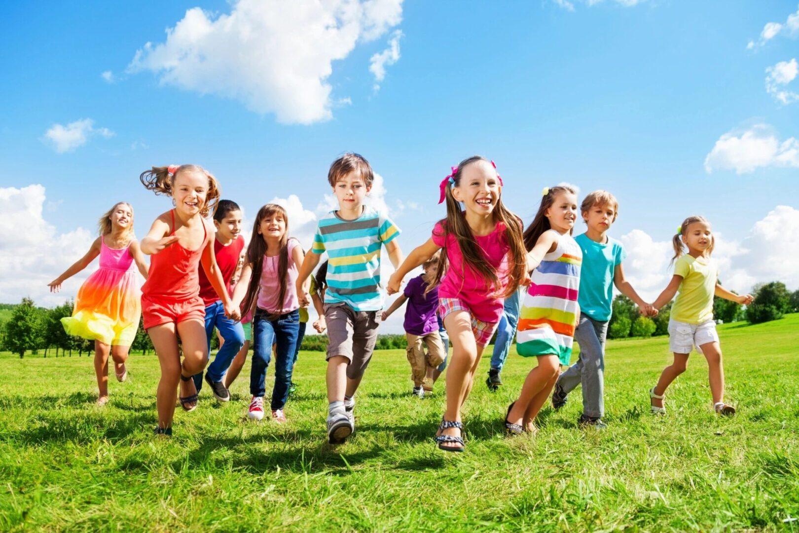 11 Children running on the grass
