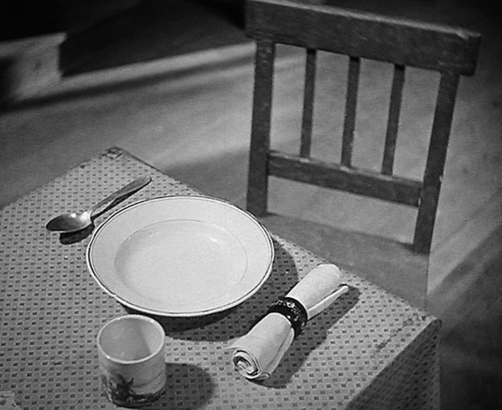 empty chair at dinner table