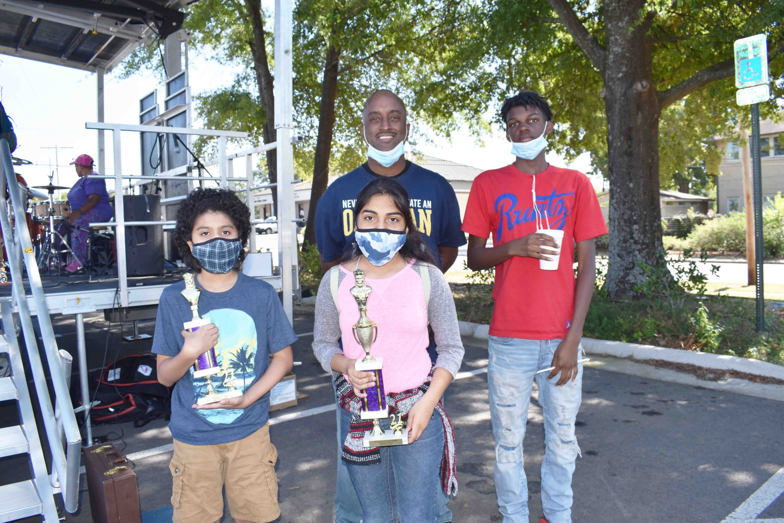 Christian Aguinaga (6th grade chess champion), Kaitlyn Aguinaga (9th grade chess champion), Darius McCree, Sr. (chess coach), Mikel Green (11th grade chess champion)