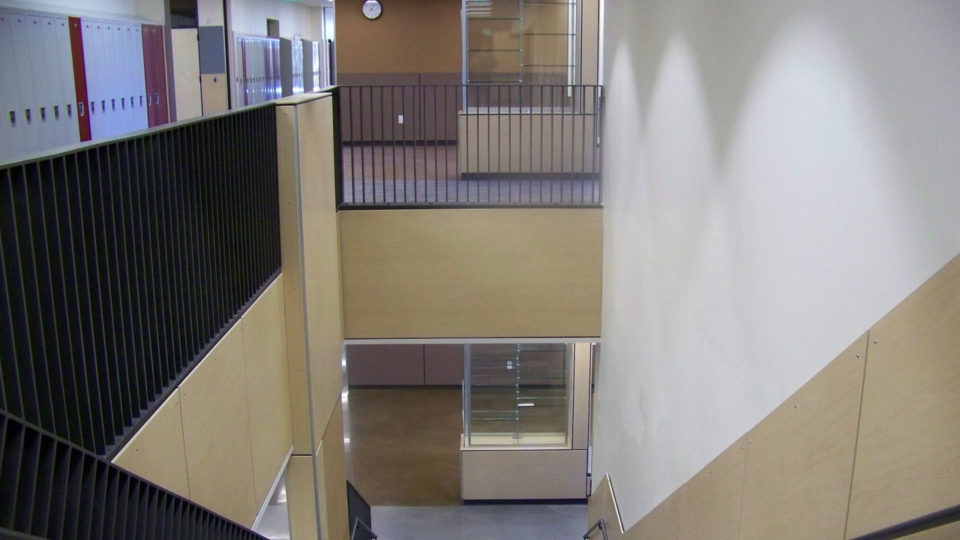 School stairway with wood paneling on the walls