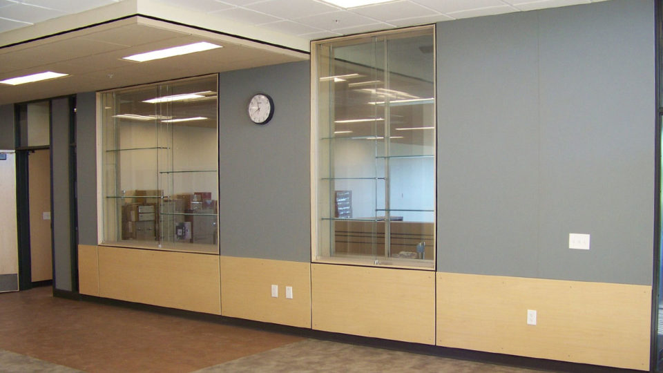 Multiple glass display cases with wood paneling