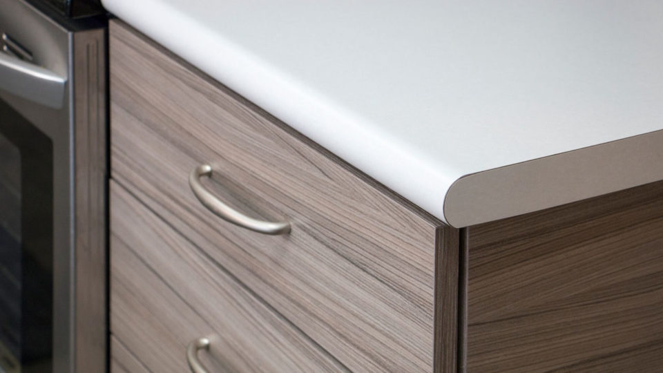 close up of kitchen counter and cabinet drawer
