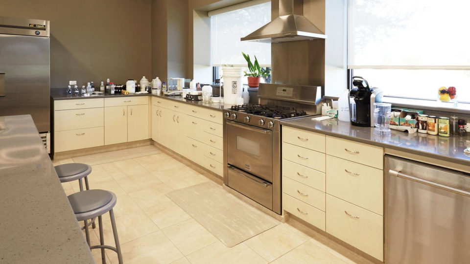 Healthcare kitchen cabinetry with stainless steel appliances