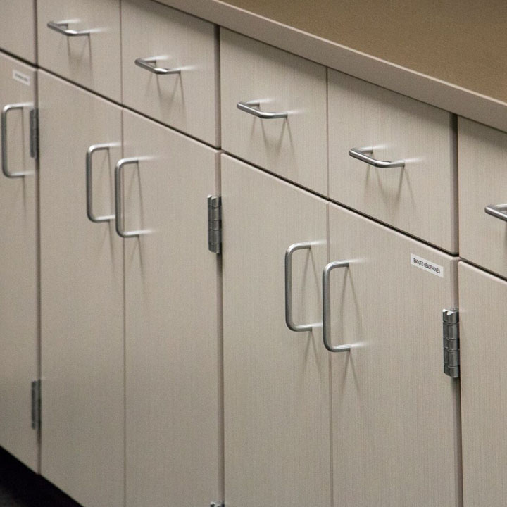 close up image of light colored cabinetry doors with silver handles