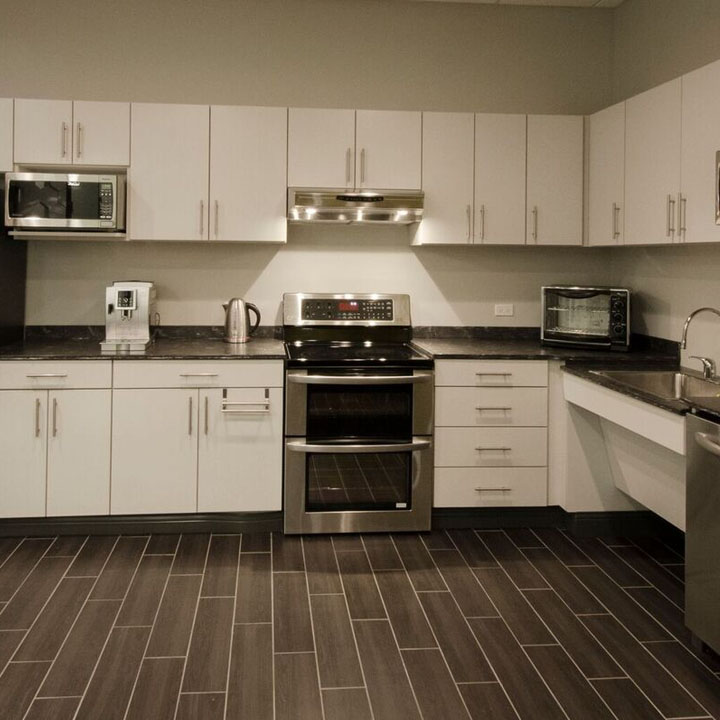light colors kitchen cabinetry with dark colored countertops