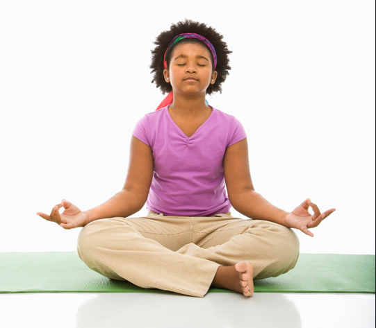 Black girl in yoga lotus pose