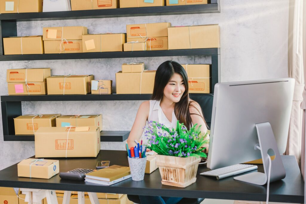 Young asian owner business woman work at home for online shopping, using video marketing