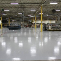large warehouse with light grey epoxy flooring
