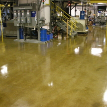 Clear Epoxy Sealed Concrete in a manufacturing facility