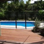 Deck merbau with pool fence