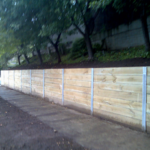 Retainer treated pine sleepers with galv supports