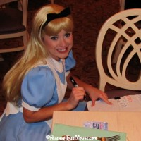 Alice signing the pillowcase