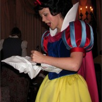 Snow White signing the pillowcase