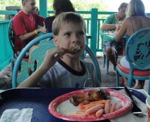 Kevin enjoying a food allergy-free meal at Flame Tree BBQ