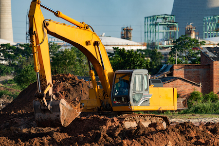 excavator moving dirt, yellow