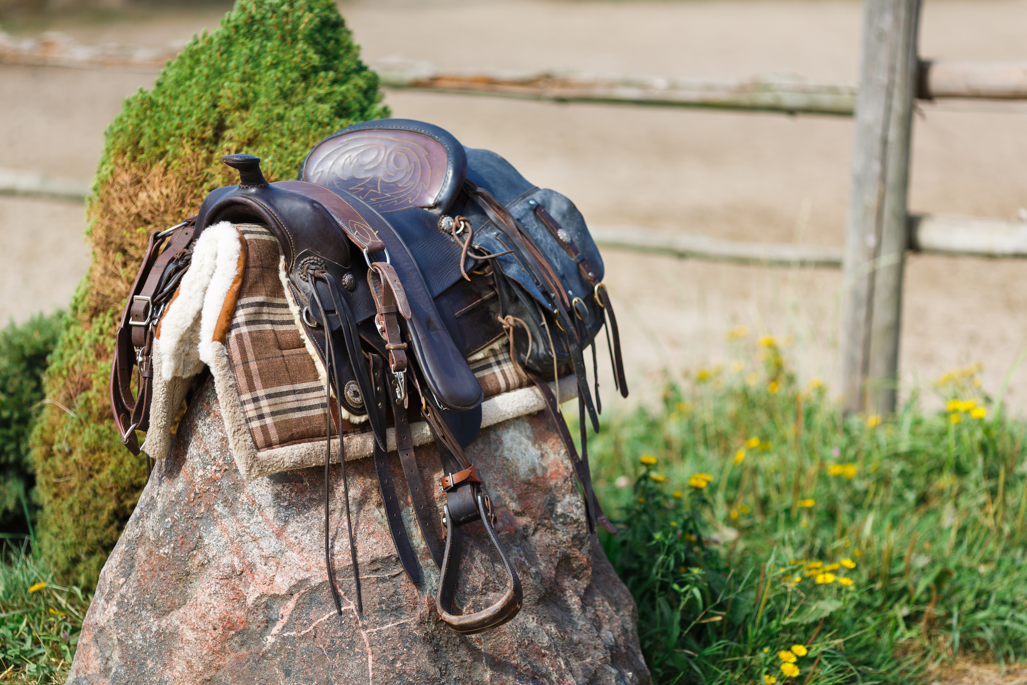 Old ornamental saddle on the stone outdoor