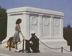 "A sailor and a girl visit the Tomb of the Unknown Soldier in 1943 CREDIT: Collier, John photographer. ""Sailor and Girl at the Tomb of the Unknown Soldier, Washington, D.C.,"" 1943. Prints and Photographs Division, Library of Congress. Reproduction Number LC-DIG-fsac-1a34521."
