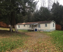Nice and private on 5 acres on a back country road sits this fully renovated mobile home. Move in condition.  Quiet, nice back yard that takes you into the woods.
