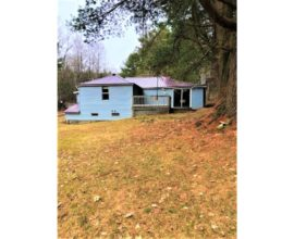 Year round, country home with 3 bedrooms, 1 bath site on 1/2 acre