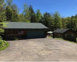 Custom built home tucked away on nearly 17 1/2 acres!