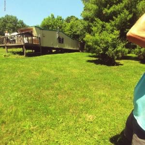 25+ ACRES WITH MOBILE HOME BORDERING STATE LAND