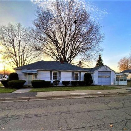 One level home sitting on a beautiful corner lot.