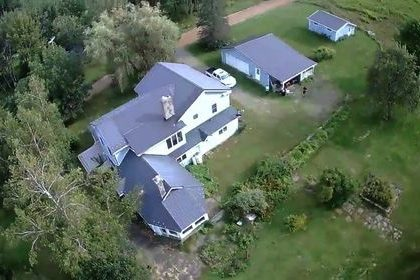 H1 - 60 acres and a stellar home on a well maintained secondary road.