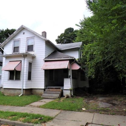 H32 - This home needs work but has good bones.  The back yard is flat and fenced in.