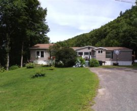 H6 - This well maintained 5 bedroom 3 full bath home sits on 27.89 mostly wooded acres just outside village limits